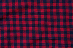 Cloth checkered texture with square blue and red stripes. Close-up Royalty Free Stock Photo