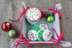 Cloth christmas basket with shortbread cookies and hot chocolate. Royalty Free Stock Photo