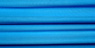 Cloth. Creased blue cloth material fragment as a background texture Royalty Free Stock Image