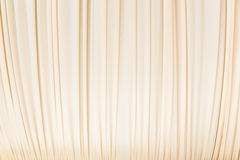 Cloth curtain in pastel yellow colour Stock Photography