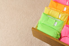 Cloth diapers. Drawer with multi-colored cloth diapers. With copyspace Royalty Free Stock Photos