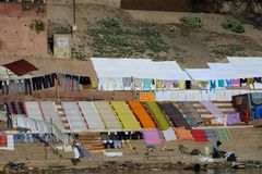Cloth are drying in bank of  Holy River the Ganges in  Varanasi, Uttar Prodesh, India. stock photos