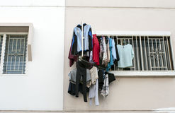 Cloth drying outside apartment window Stock Photography