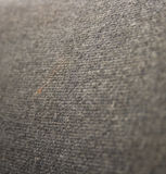 Cloth fabric. Texture of a grey thick cloth fabric. Shallow DOF Royalty Free Stock Photo