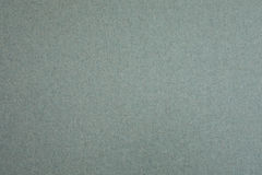 Cloth of felt in grey and blue as isolation. At a wall royalty free stock images