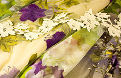 Cloth and Flowers Stock Images