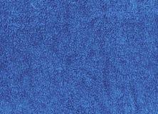 Cloth, fuzzy towel texture. A flat texture of a fuzzy blue cloth towel Stock Photo