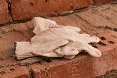 Cloth gloves on bricks Stock Image