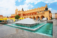 Cloth Hall on Rynek Glowny and fountain in Krakow Royalty Free Stock Images