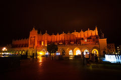 Cloth Hall on Rynek Glowny and fountain in Krakow Royalty Free Stock Photos