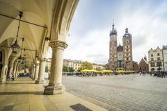 Cloth Hall and St. Mary`s Basilica on Market Square in Krakow, P Royalty Free Stock Photo