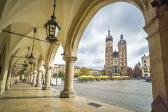 Cloth Hall and St. Mary`s Basilica on Market Square in Krakow, P Stock Photos