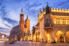 St Mary s Church at Main Market Square in Cracow, Poland. Cloth Hall and St Mary s Church at Main Market Square in Cracow, Poland Stock Photo