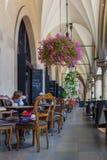 Cloth Hall (Sukiennice) column corridor- cafe restaurant-Cracow, Poland Stock Photos