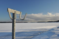 Cloth hanger on frozen winter landscape Stock Photos