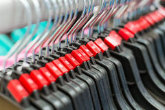 Cloth hanger with red sizing label Royalty Free Stock Photos