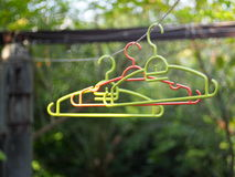 cloth hanger under direct sunlight with green outdoor environment background Stock Photos