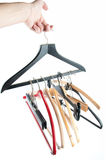 Cloth hangers. Man hand held different cloth hangers, isolated Stock Image