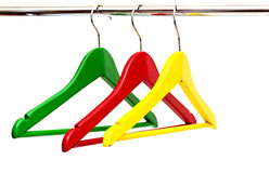 Cloth hangers. Close up of colorful cloth hangers in row on white background Stock Photo