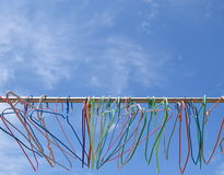 Cloth hangers and blue sky. Cloth hangers outdoor and bright blue sky Stock Images