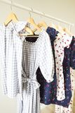 Cloth Hangers with dresses. Women`s  clothes. Close up Stock Image