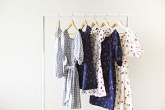 Cloth Hangers with dresses. Women`s  clothes. Copy space Stock Photos