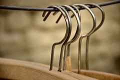 Cloth Hangers. With Rusty Metal Texture Royalty Free Stock Images