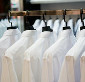 Cloth hangers with shirts. Row of cloth hangers with shirts Stock Image
