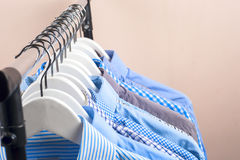 Cloth Hangers with Shirts. Men`s clothes Stock Photo