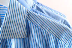 Cloth Hangers with Shirts. Men`s clothes Royalty Free Stock Images