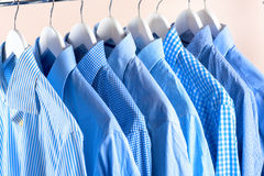 Cloth Hangers with Shirts. Men`s clothes Royalty Free Stock Photography