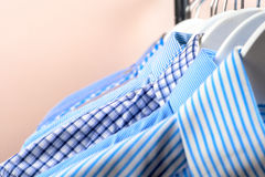 Cloth Hangers with Shirts. Men`s clothes Stock Images