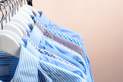 Cloth Hangers with Shirts. Men`s clothes Royalty Free Stock Photos