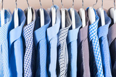 Cloth Hangers with Shirts. Men`s clothes Stock Photography