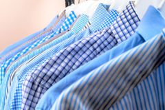 Cloth Hangers with Shirts. Men`s clothes Stock Image