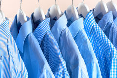 Cloth Hangers with Shirts. Men`s clothes Royalty Free Stock Photo