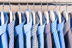 Cloth Hangers with Shirts. Men`s clothes. Clothes hang on a shelf . Cloth Hangers with Shirts. Men`s business clothes Royalty Free Stock Photos