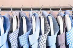 Cloth Hangers with Shirts. Men`s clothes. Clothes hang on a shelf . Cloth Hangers with Shirts. Men`s business clothes Royalty Free Stock Image