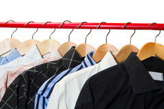 Cloth Hangers with Shirts. Cloth Hangers with some Shirts royalty free stock photo