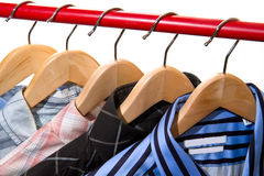 Cloth Hangers with Shirts. Cloth Hangers with some shirts royalty free stock images