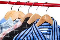 Cloth Hangers with Shirts Stock Photo