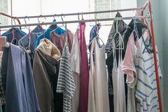 Cloth hanging on the clothesline at indoor balcony after wash Royalty Free Stock Photography