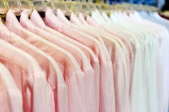 Cloth hanging in store. Close up of the cloth hanging in store Royalty Free Stock Photos