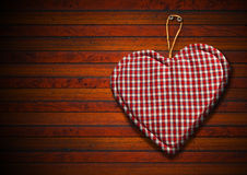 Cloth Heart on Brown Wood Background. Handmade clothe heart hanging on brown wooden background Stock Image