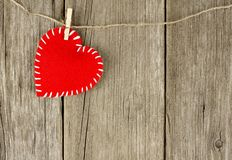 Cloth heart on clothesline Royalty Free Stock Images