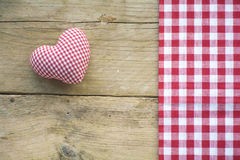 Cloth  heart and fabric with red and white checked pattern on ru Stock Photo