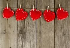 Cloth hearts on clothesline Royalty Free Stock Photography