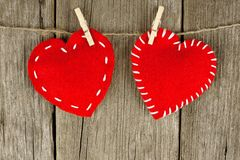 Cloth hearts on clothesline Stock Photos