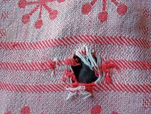 Cloth hole Stock Photo