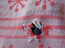 Cloth hole Stock Photo